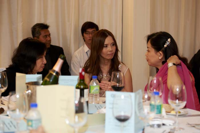 Ms. Phan Siew Yin, Dr. Christina Ng and an esteemed guest having a lively exchange