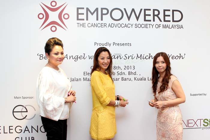 The officiating of 'Be an Angel with Tan Sri Michelle Yeoh', signing of the official event backdrop
