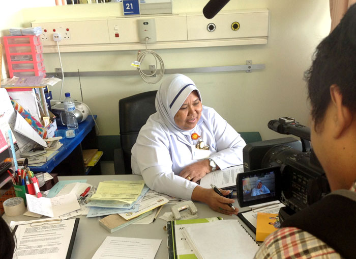Interviewing nurse Jannah at her work station